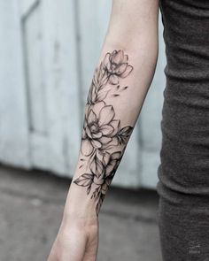 Blackwork peonies on the right forearm.