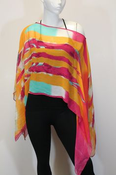 Beautiful chiffon scarf, that can be worn in several different ways! Completed with a unique colorful pattern. One Size, 100% Polyester. Style BKK-711