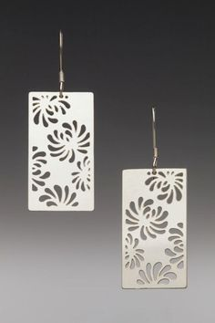 www.sarahboodesigns.com Flat Pierced Rectangular Chrysanthemum Earrings.  These earrings are light and airy and sparkle with a polished finish as they swing from the ears. They are inspired by Japanese kimono fabric designs.  They are made of sterling silver, flat, rectangular shapes which are 22 gauge in thickness. They are pierced with a design of chrysanthemums. The ear wires are also made of sterling silver.