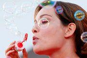 Italian actress Christiane Capotondi entertains journalists with soap bubbles