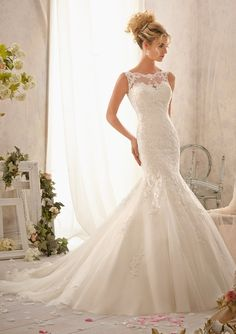 Beautiful crystal beads glisten and highlight the amazing design of this beautifully flowing wedding dress. Delicate embroidered lace brings this romantic