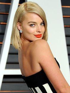 Margot Robbie orange-red lipstick | allure.com