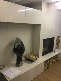 Our bespoke Lapitec Branco Crema Lux Fireplace and cupboards made here in our Colney Heath workshop, displayed with Barbas Evo 80/65 woodburning stove with guillotine door and remote control. Sculpture  is Shona 'Jewel of Life'. All available in our Colney Heath Showroom. We can make any items to fit customer requirements out of Stone, Granite, Marble, Quartz Stone & Lapitec.