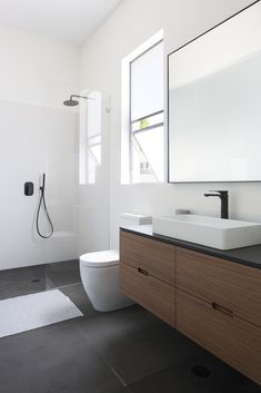 If you're wondering how to decorate a bathroom, you'll love these small bathroom design ideas. Create a stylish bathroom with big impact with our easy small bathroom decorating ideas. Bathroom Vanity Designs, Bathroom Layout, Modern Bathroom Design, Bathroom Interior Design, Bathroom Ideas, Bathroom Storage, Bathroom Organization, Serene Bathroom, Minimalist Bathroom Design