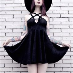 Black Magi skater dress with pentagram-strap detail & black round hat by tequilastar