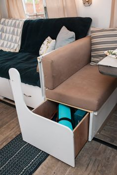 Brittany & Jordan's Cozy, Modernized, DIY Cross-Country Camper - I like this idea of drawer style storage under a bench
