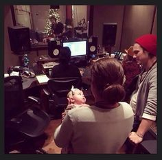 Taylor, Zac and baby Lucy with Isaac in the background in the studio