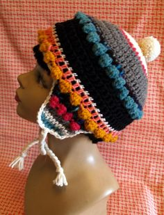 This multicolored hat is full of fun colors and bobbles that remind me of the frosting on a birthday cake. Its made from bits of wool (some handspun) &