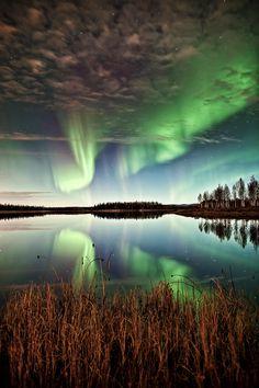September aurora reflects in lake - Alaska