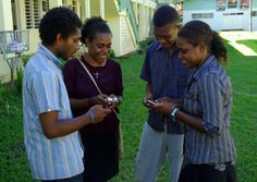 Group of young people texting on mobile phones.