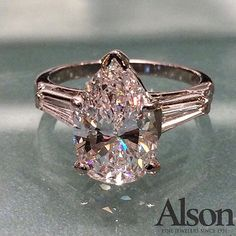 Elegant and classic 3.38 carat pear-shaped diamond with baguettes. www.alsonjewelers.com