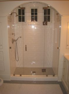 Tracery Interiors | lovely arched master shower