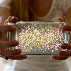 "Cut glow stick, pour contents into jar and add glitter.  Glow ""fairies""!"
