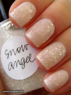Simple manicure reminiscent of freshly fallen snow with this white Glitter snow angel polish...x