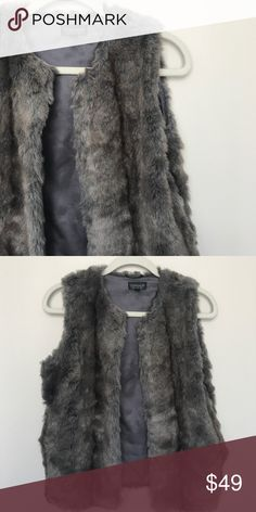 TOPSHOP Gray Faux Fur Vest Gorgeous, faux fur vest from Topshop. Worn once. Front hook and eye closure. Fully lined. Topshop Jackets & Coats Vests