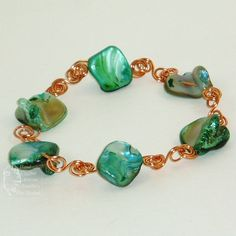 Simple Green Shell beads and Copper Wire Bracelet. This is a large bracelet approximately 9 inches long. £12.00