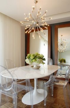 Sputnik chandelier, ghost chairs, tulip table