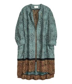 CONSCIOUS EXCLUSIVE. Jacquard-weave coat in a blend of recycled polyester and mulberry silk containing glittery threads. The coat is oversized with 3/4-length sleeves and flap pockets and is completely open at the front with slits in the sides. Slightly longer at the back. Unlined.