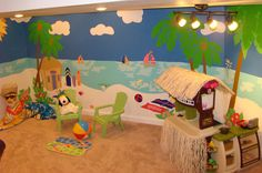 What a great way to turn a bedroom, playroom or basement into a tropical paradise. With this paint-by-number wall mural they were able to extend the mural, change colors, repeat elements and then top it off with fun accessories and a carpet that looks like sand. You can almost feel the sand between your toes! #KidsDecor