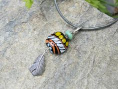 sterling silver feather pendant and lampwork necklace custom length lisa new design artisan jewelry by lisanew on etsy