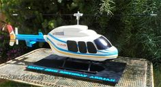 3D Helicopter with spinning propellors cake - Cake by customcakedesignsoz   wow wow wow