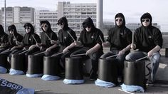 """German Bucket Drummers playing easy music that looks impressive. Proof that the difference between ordinary and extraordinary is just that little """"extra"""" -- matching clothes, sticking, planning, etc."""