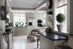 White kitchen with black counters! The only way I can stand a mostly white kitchen....