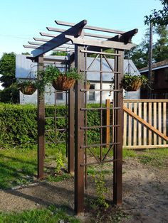 """""""Frame Your Garden With a DIY ArBOR. Set the scene for curb appeal or a beautiful backyard detail with this arbor you can inexpensively build yourself"""""""