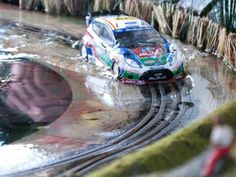SCX rally car in water