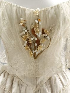 Wedding dress detail, 1848 (silk, embroidered net, lace, mother of pearl)~Image via V&A Museum