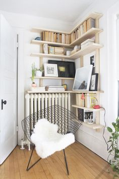 Free wall space makes a great backdrop for a homemade bookcase. This corner shelving from Deuce Cities Henhouse is easy enough for beginners to customize to their space. Get the how-to »   - HouseBeautiful.com