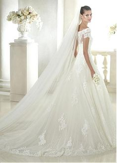 Elegant Tulle Bateau Neckline Natural Waistline A-line Wedding Dress With Beaded Lace Appliques