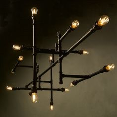 Plumbing Pipe 16 Bulb Chandelier. This imposing chandelier can be used to light up a large dining table, a boardroom table or