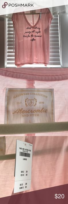 Abercrombie & Fitch side slit t-shirt Abercrombie & Fitch side slit t-shirt. Light pink with velvet script- NWT Abercrombie & Fitch Tops Tees - Short Sleeve