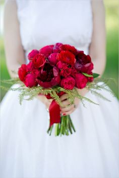 red wedding bouquet #redbouquet #themedwedding #wizardofoz http://www.weddingchicks.com/2014/01/09/wizard-of-oz-wedding-ideas/