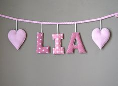 A very special gift for birthday or baby shower: This cute name garland is perfect to be fixed over bed or on nursery wall. Single letters and hearts are made of nice colorful cotton-fabrics and filled with soft padding. On each side there is a 30cm-ribbon left for individual fixing.