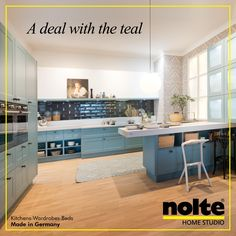 The Opal soft matte front of the Frame Lack kitchen has a touch of teal.  Visit: www.noltehomestudio.in/kitchens #kitchens #noltehomestudio #noltekitchens #notlehomestudioindia #india #modularkitchens #cabinets #worktop #luxeliving #home