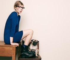 Perfect blue dress, black biker boots, matching blue socks and a pug dog. Can't ask for more