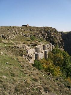 Bjni Fortress (Armenian: Բջնի Բերդ is a castle located in the village of Bjni in the Kotayk Province of Armenia. It sits upon the top and along the sides of a mesa that divides the village nearly in half. The larger portion of which is located west of the mesa and curves south, while a smaller portion is east.