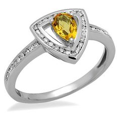 This simple 14k white gold ring features a lovely 0.36ct pear shaped citrine gemstone surrounded by brilliant round cut diamonds. The color of the diamonds are G/H and the clarity is SI2/SI3.Different ring sizes may be available. Please inquire for details. $270.00
