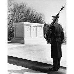 Rear view of an army soldier standing near a memorial Tomb of the Unknown Soldier Arlington National Cemetery Arlington Virginia USA Canvas Art - (24 x 36)