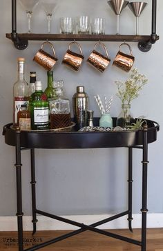 e46211bbd08 Where do you hang your moscow mules  - urban market black tray table with  industrial pipe shelf above with moscow mule copper mugs