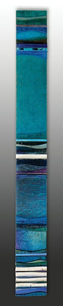 Mosaic Aqua Marina I by Alicia Kelemen. This mosaic assemblage is created from fused glass, colored mirror, and travertine. Iridescent elements add to the shimmering quality of this wall sculpture. The elements are laminated to an MDF base, with walnut edge, ready to hang vertically or horizontally. Limited edition of 150.