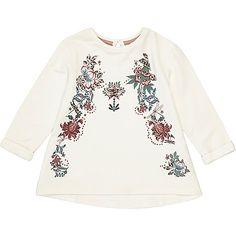 Floral embroidery detail Crew neck Long sleeve Loop back fastening Swing hem