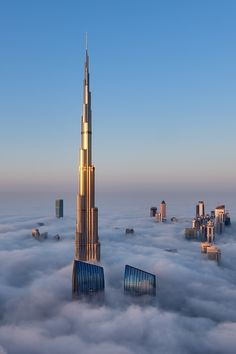 A close-up view of the majestic Burj Khalifa surrounded by a thick blanket of fog. by Daniel Cheong