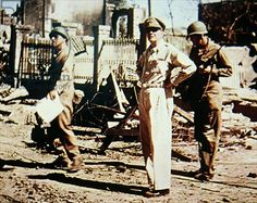 General MacArthur surveys the damage in the Ermita district of Manila, Philippines, March 1945 (photo)