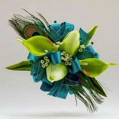 Peacock feathers are a big #prom corsage trend for 2013.