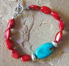 Handmade coral and Kingman turquoise bracelet with handcrafted Thai silver #handmade #jewelry #bracelet  handmade-beaded-gemstone-jewelry.com/