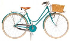 Lovely turquoise Italian-style city bike frame. Love the wicker basket with the colour!