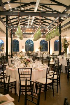 """{   RUSTIC + CHIC ST. LOUIS WEDDING   }  Jess and Bassey combined neutral tones with a botanical feel for their St. Louis wedding. Kristin Ashley Events curated the event, pulling together bohemian details, such as a feather at each place setting, with organic elements like the unique baby's breath reception chandelier. Bloomin' Buckets created centerpieces in accents of pink and green to bring color to the earthy palette of the Forest Park Visitors Center."""""""